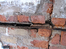 Rusting of steel beam in brickwork.